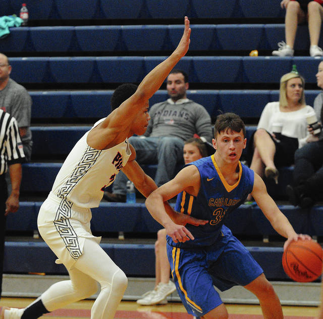 Rob Kiser|Call Photo Lehman Catholic's Luke Frantz makes a move to the basket against Piqua's Trey Richmond.