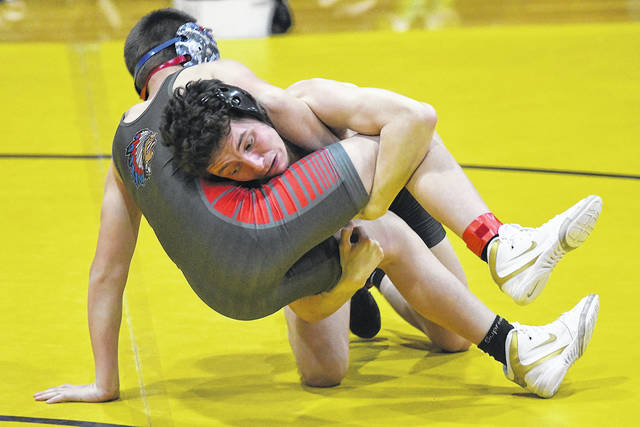 Ben Robinson|GoBuccs.com Covington's Riley Richards controls his opponent at the Northeastern Invitational Saturday.