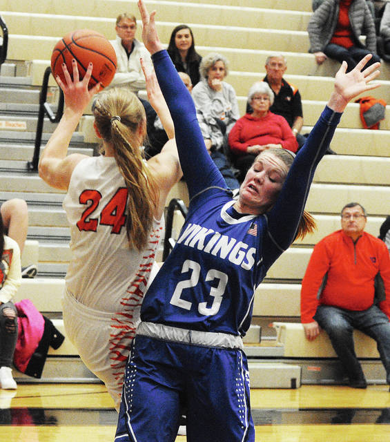 Rob Kiser|Call Photo Versailles' Liz Ording makes an off-balance pass as Miami East's Whitley Gross defends.