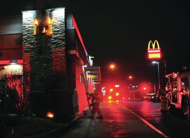 Mike Ullery | Troy Daily News Troy firefighters work to extinguish a fire at the McDonald's on West Main Street in Troy on Wednesday evening.