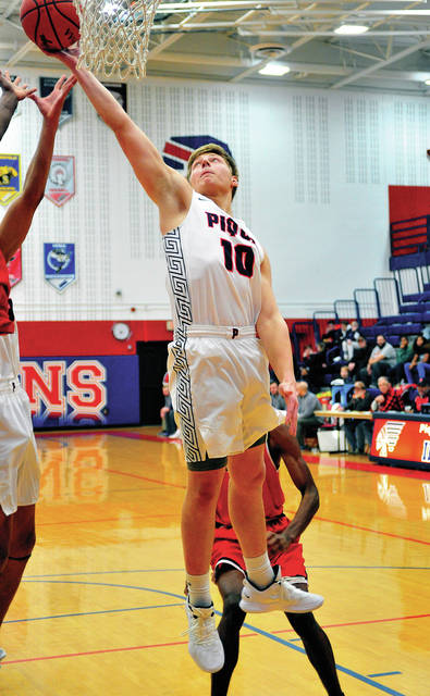 Piqua's Makeegan Kuhn goes up for an offensive rebound Friday night.