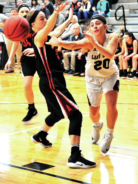 Covington's Morgan Kimmel passes the ball cross-court for an assist against Arcanum.