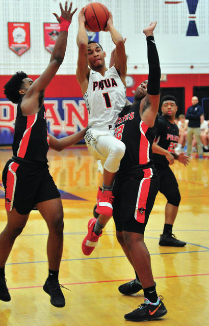 Piqua's Qurri Tucker beats a West Carrolton double team Tuesday at Garbry Gymnasium.