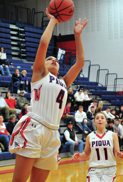 Piqua's Tylah Yeomans scores two points against Xenia as Andrea Marrs looks on.