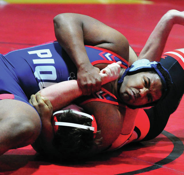 Piqua's Lance Reaves-Hicks records a pin against Tecumseh Wednesday at Wayne High School.
