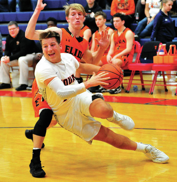 Piqua's Mick Karn drives past Elida's Evan Unruh Tuesday night.