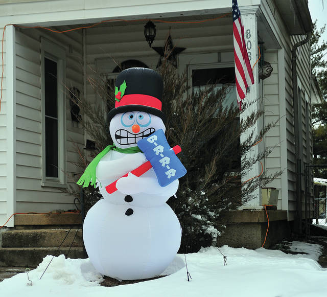 Mike Ullery | Daily Call This shivering Frosty the Snowman on North Street in Piqua seems to have nailed the prediction for our weather forecast in coming days!