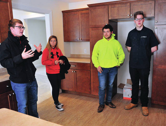Mike Ullery | Daily Call Upper Valley Career Center senior Braeden Snider, left, a Landscape Management student from Troy High School, talks about his part in the construction of the latest project home built by career center students. With Snider are Rebecca Osborne who is part of the HVAC program, Keegan Webb from the Carpentry Program, and Corey Werst from the Electrical Trades program. Osborne is from Russia High School, and both Webb and Werst attend Troy.