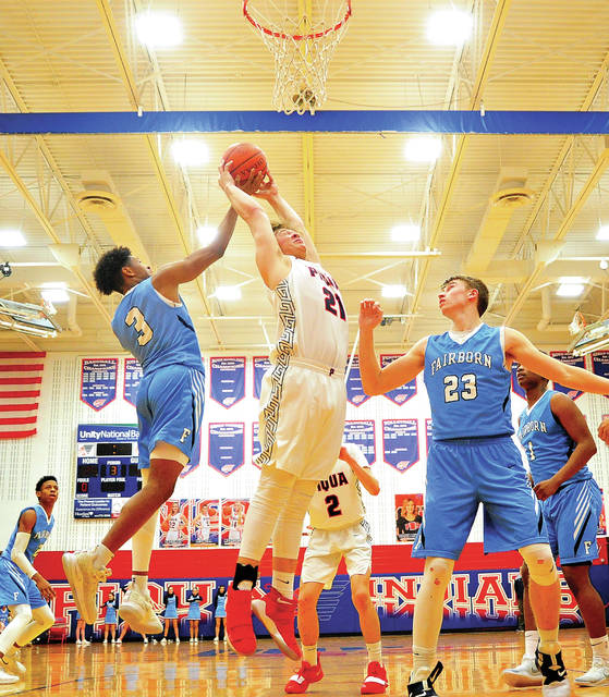 Piqua's Zach Tillman pulls down a rebound between Fairbo Shaunn Monroe (3) and Jarod Bodekor (23) Tuesday night at Garbry Gymnasium.
