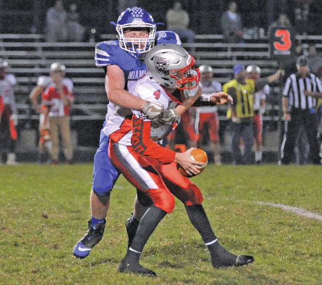Josh Brown|Miami Valley Today file Miami East's Austin Kearns sacks the Tri-County North quarterback during a Cross County Conference game in the 2017 season.