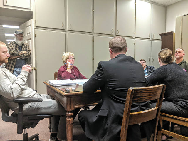 Cecilia Fox | Troy Daily News The Miami County Board of Elections voted Tuesday night to fire Director Beverly Kendall, center.