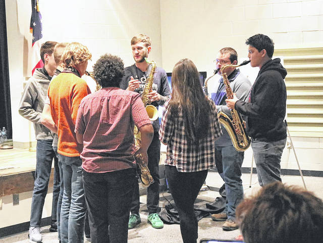 Provided photo Lucky Chops saxophonist Daro Behroozi gives pointers to local students during a music education clinic held at Edison State Community College.