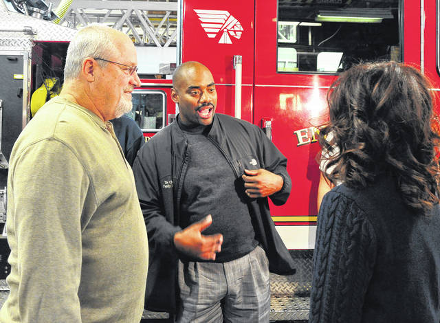 Mike Ullery | File photo Retired NFL linebacker Chris Draft, center, chats with Jeff and Rhonda Meckstroth at the Piqua Fire Department in November 2017. Jeff, who is retired from the fire department, is currently battling lung cancer. Draft lost his wife to the disease several years ago.