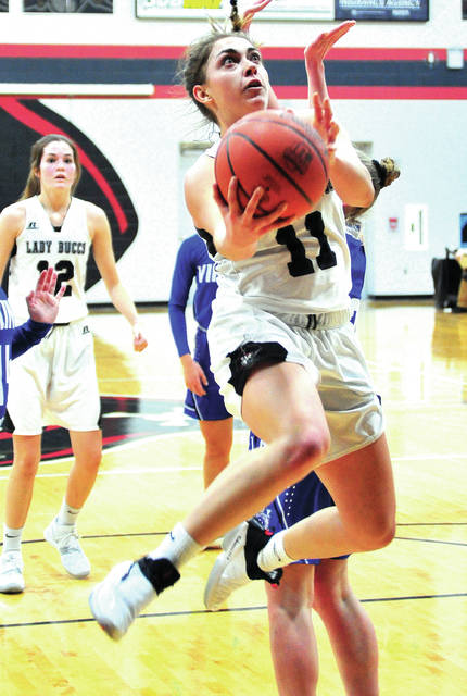 Covington's Sammmi Whiteman goes up for two of her 29 points against Miami East Thursday night.