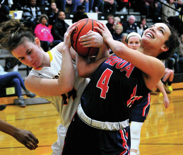 Piqqua's Tylah Yeomans and Sidney's Hallie Truesdale battle for a rebound Saturday at Sidney High School.