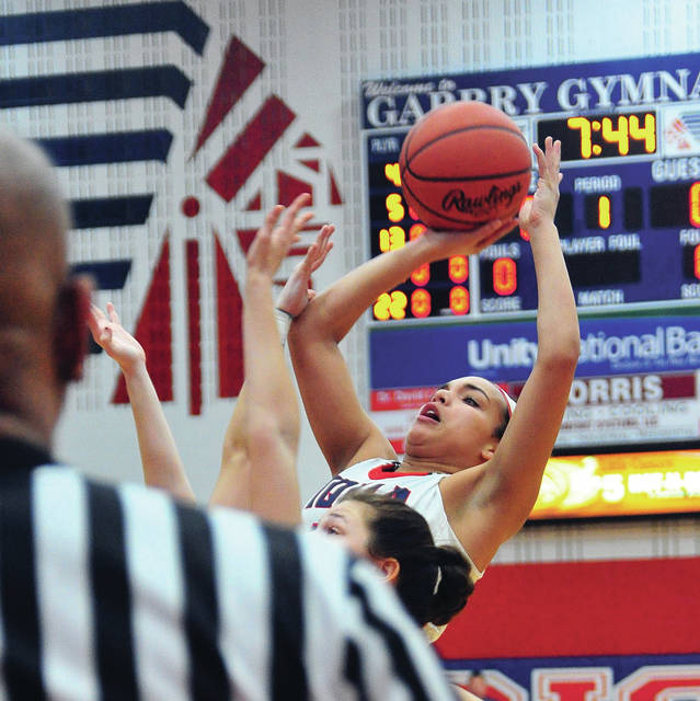 Piqua's Tylah Yeomans gets off a jumper against Greenville Thursday at Garbry Gymnasium.