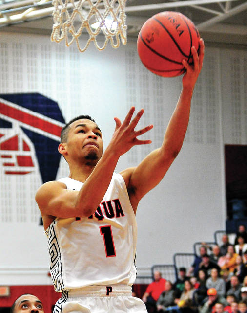 Piqua's Qurri Tucker goes up for two points against Sidney Friday night at Garbry Gymnasium.