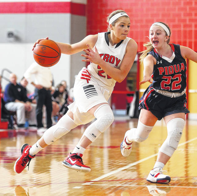 Lee Woolery|Miami Valley Sunday News Troy senior Lauren McGraw drives around Piqua's Kelsey Bachman during Saturday's Senior Night game at the Trojan Activities Center.