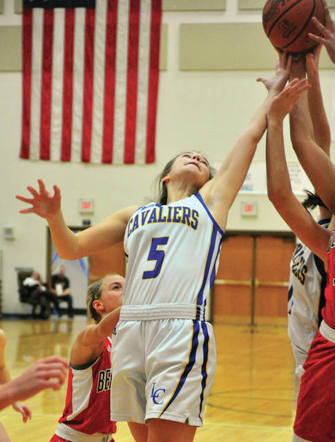 Lehman Catholic's Rylie McIver goes up for a rebound Saturday against Bellefontaine.
