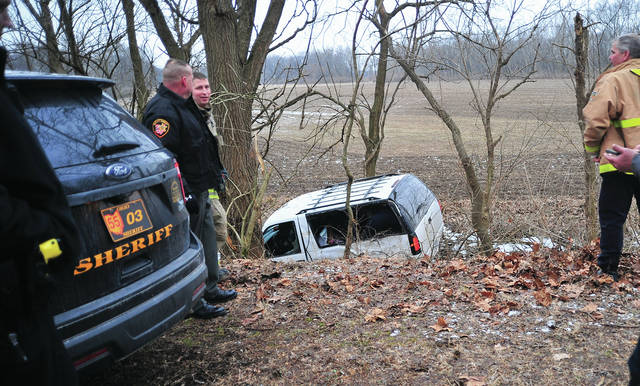 Miami County sheriff's deputies and Troy firefighters investigate a crash on the bike path between State Route 202 and the Miami River that involved an SUV that was reported stolen over the weekend.