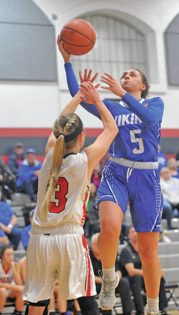 Josh Brown|Miami Valley Today Miami East's Morgan Haney lays the ball in over a Preble Shawnee defender during Wednesday night's Division III sectional tournament game at Covington High School.