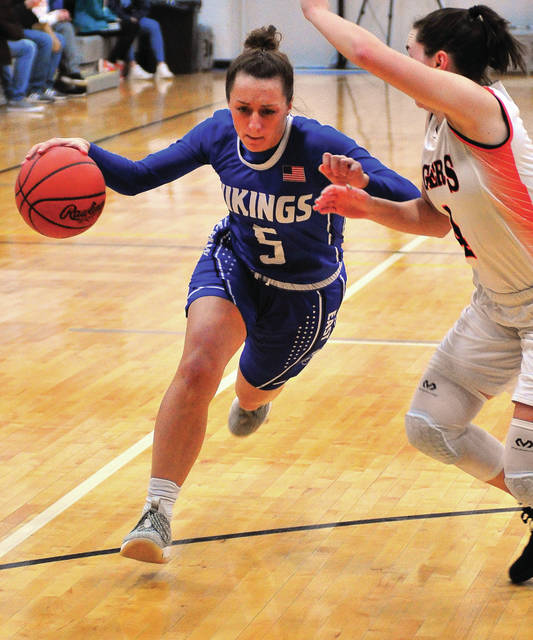 Miami East's Morgan Haney drives to the basket against West Liberty-Salem Monday night at Covington High School.