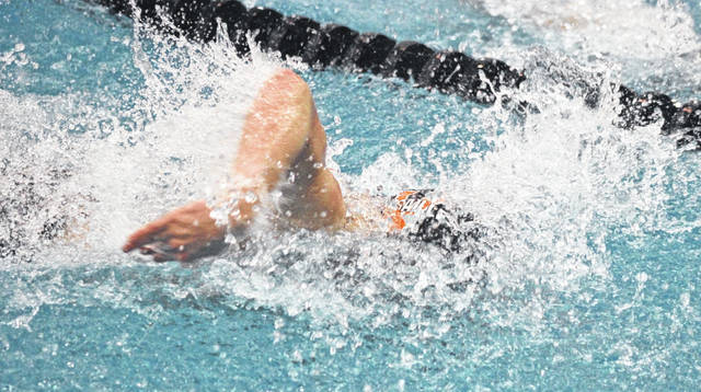 Skip Weaver|Aim Media Versailles' Cole Condon swims in the 50 freestyle Friday at the Canton Natatorium.