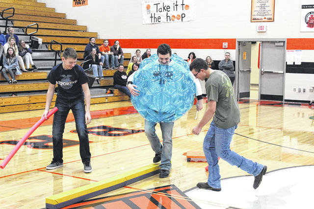Provided photo Taven Leach, Tevin Felver, Keaton Mead participate in an FFA assembly on Friday of FFA Week.