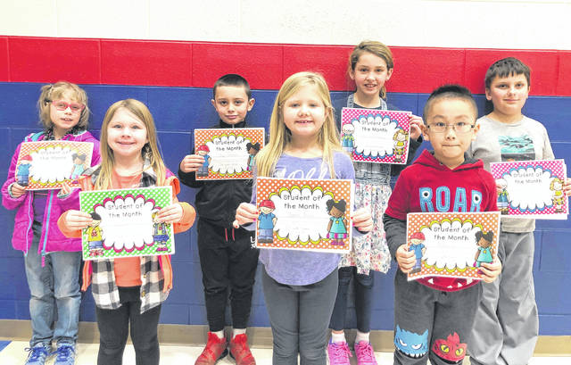 Provided photo Springcreek Primary School Students of the Month for February are, front row, left to right: Lily Horner, Joanna Russo, Anthony Liu; back row, left to right: Madison Gray, Koby DeVilbiss, Libby Jane Magoteaux, Jeffrey Grote. The students were selected for showing kindness, responsibility, and respect to the Springcreek staff and their peers.