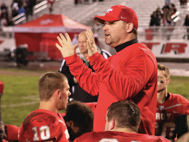 Lee Woolery | Miami Valley Today file photo Troy football coach Matt Burgbacher, shown here talking to his team following a win last season, announced Tuesday he is leaving Troy to become the head coach at Tippecanoe High School.