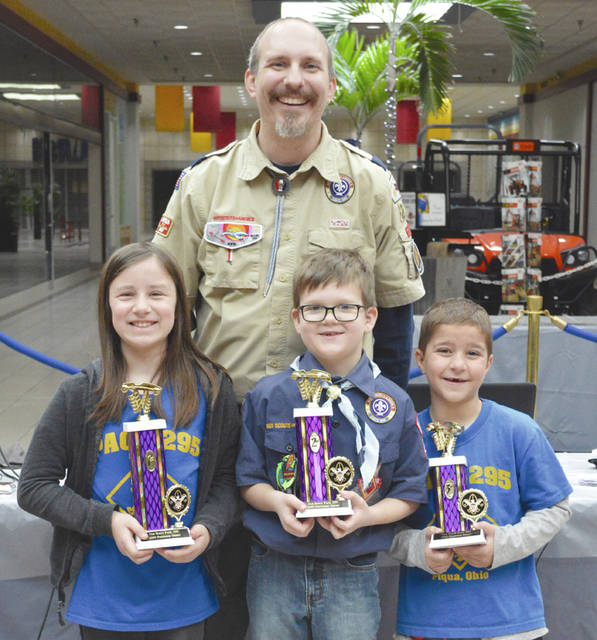 Provided photo The top three overall winners were, from left, Laurie VanMatre, Tristan Fox and Jack Grise, along with Cubmaster Adam Bishop.