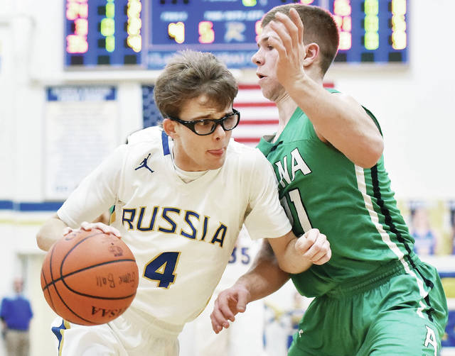 Luke Gronneberg|Aim Media Photo Russia's Mason Dapore drives against Anna's 21 Riley Huelskamp at Russia Tuesday.