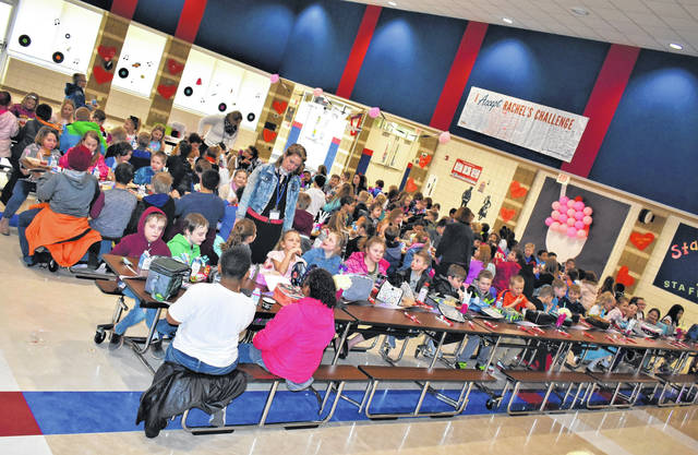 Cody Willoughby | AIM Media Midwest Hundreds of third graders enjoy burgers and fries during the Valentine's Day Sock Hop on Thursday at Springcreek Primary in Piqua.