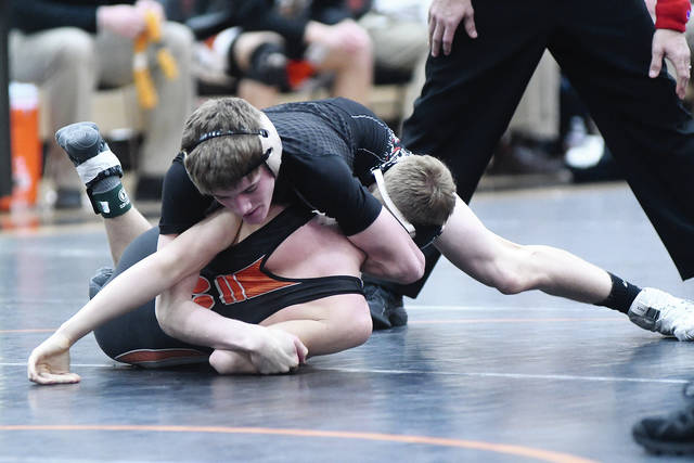 Ben Robinson|GoBuccs.com Covington's Cael Vanderhorst is in control against Versailles' Noah Brown in a 120-pound match.
