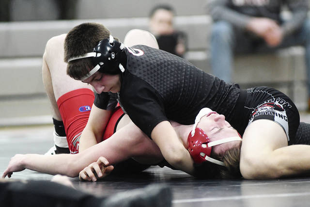 Ben Robinson|GoBuccs.com Covington wrestler David Robinson pins his opponent in a 145-pound match.