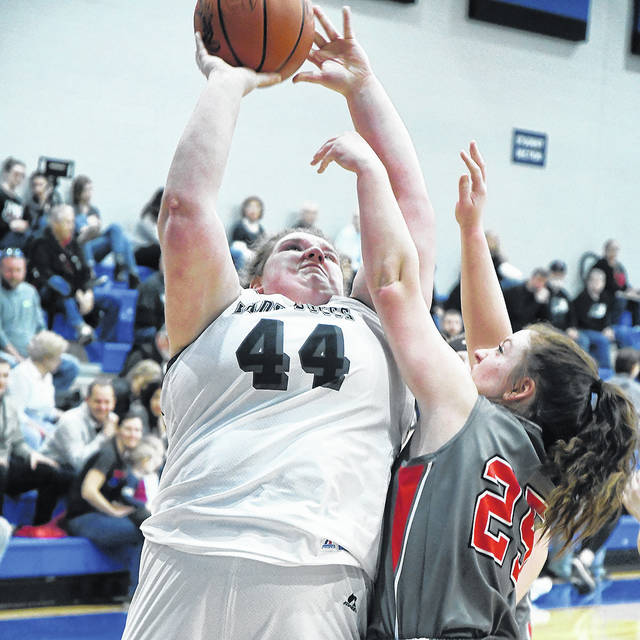 Ben Robinson|GoBuccs.com Covington's Lauren Christian shoots as Tri-County North's Lexi Delong defense Saturday in Brookvill D-IV action.