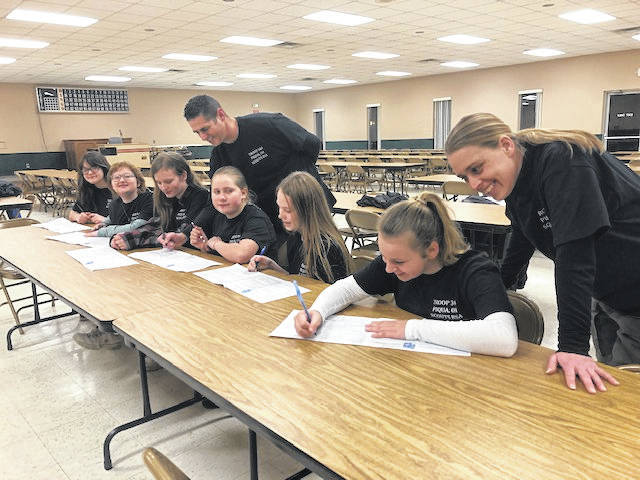 Members of Troop No. 344 signed their official applications to join Scouts BSA. The girl troop, located in Piqua, has seven members, which recently allowed girls to seek rank and its Eagle Scout designations.