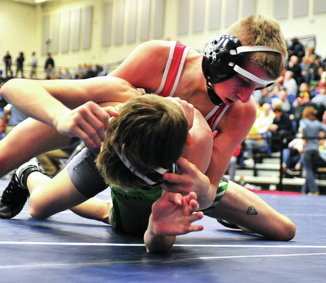 Troy's Zach Evans controls Sam Schmerr of Harrison in first-round 103 pound competition on Friday at Trent Arena.