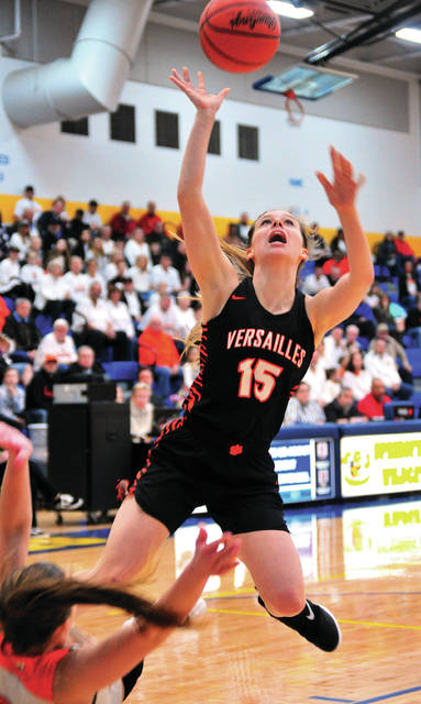 Versailles' Hannah Barga gets tangled with a Waynesille player as she goes up for a shot Wednesday night at Springfield High School.
