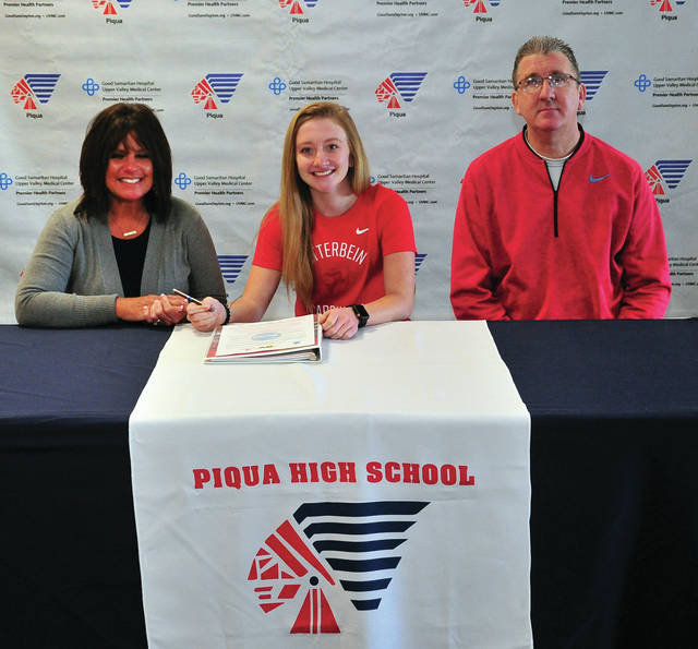 Mike Ullery|Call Photo Piqua High School senior Kelsey Bachman signed her letter of intent to play golf for Otterbein University recently. Shown with Bachman are her parent Anita (left) and Kirk (right) Bachman.