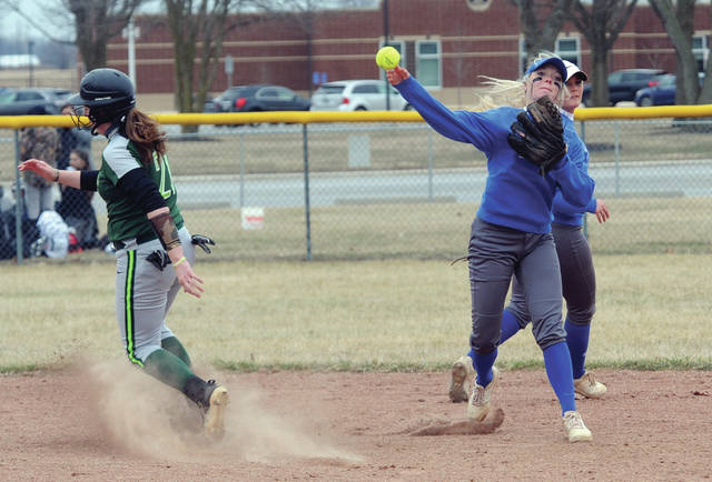 Edison State shortstop Lexie Long turns a double play against Wilmington College Tuesday.