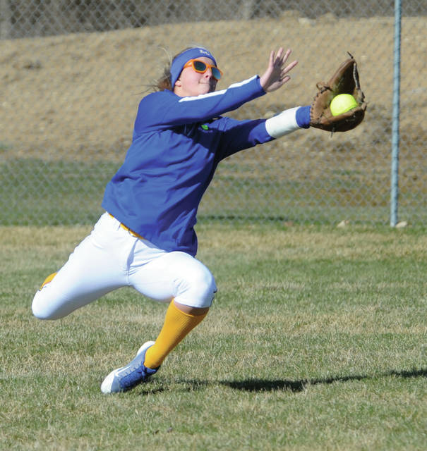 Lehman Catholic's Carly Edwards makes a diving catch in centerfield Tuesday against Piqua
