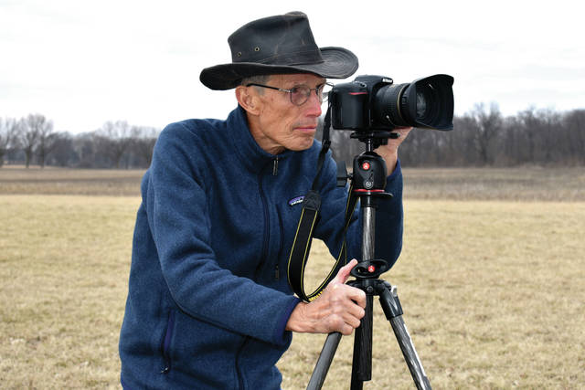 "Cody Willoughby | AIM Media Midwest Covington resident Don Angle aligns a shot with his Nikon d7500 at Lost Creek Reserve. The nature-loving photographer recently published a photo essay book, ""Finding Light in the Shadows,"" available on Amazon."