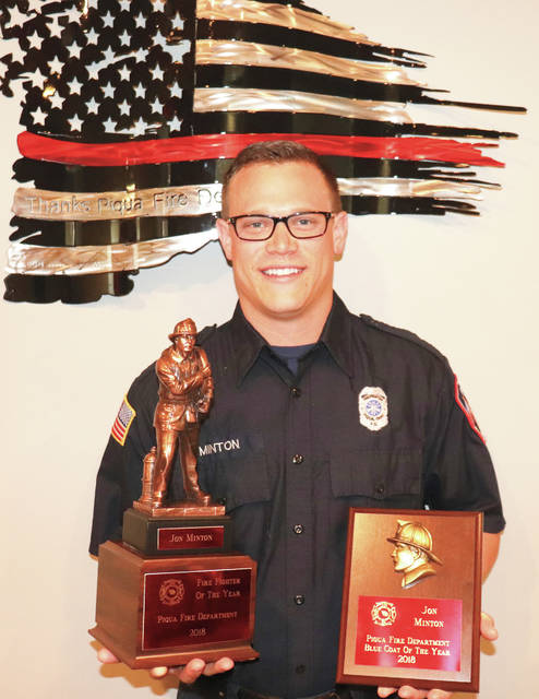Provided photo Jon Minton displays his awards for 2018 Firefighter of the Year, presented by the Piqua Fire Department. Minton has been with the department for six years.