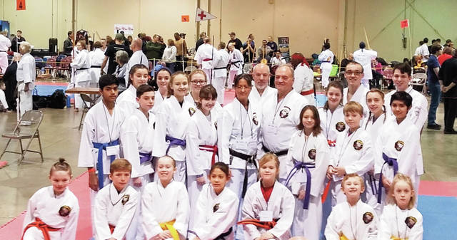 Provided photo Competitors from the Okinawan Shorin-Ryu Karate Dojo in Troy who attended the 2019 Arnold Martial Arts World Games — 43rd Battle of Columbus include, front row, left to right: Adrian Benedict, Mak Broughman, Rebecca Fortner, Ann Krug, Eve Dye, Kaiden Schweser, Chloe Swartz; second row, left to right: Suhas Nallam, Issac Targett, Sydney Bennett, Zella Younce, Sensei Christine Leistner, Sensei Jeff Leistner, McKenzie Arnett, Skyla Kerns, Colten Bennett, Abigail Twiss, Parth Rajput; back row, left to right: Hannah Summers, Bailey Tipps, Holly Beasley, Kevin O'Reilly, Collin Woolley, Ryan LeVan.