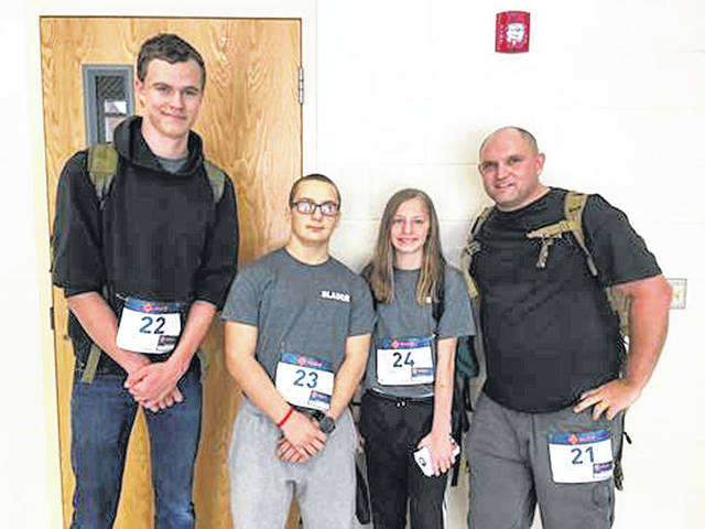Three members of the Miami Valley Young Marines recently participated in the Bataan Memorial Death March in New Mexico earlier this month. Picture from left is John Sollinger, 18, of Huber Heights, Karl Slader, 15, of Fairborn, Emma Marlow, 13, of Troy, with Unit Commander Keagan Miller of Troy.