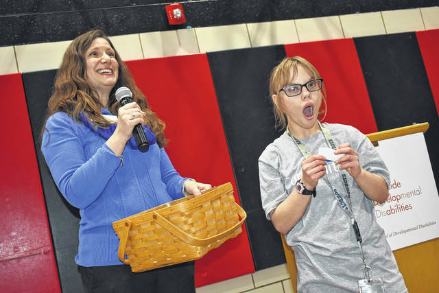 Cody Willoughby | AIM Media Midwest Executive Director Melissa Nichols and Brittany Meyer, of Fort Loramie, draw names for the raffle during the open house at Riverside Developmental Disabilities on Friday.