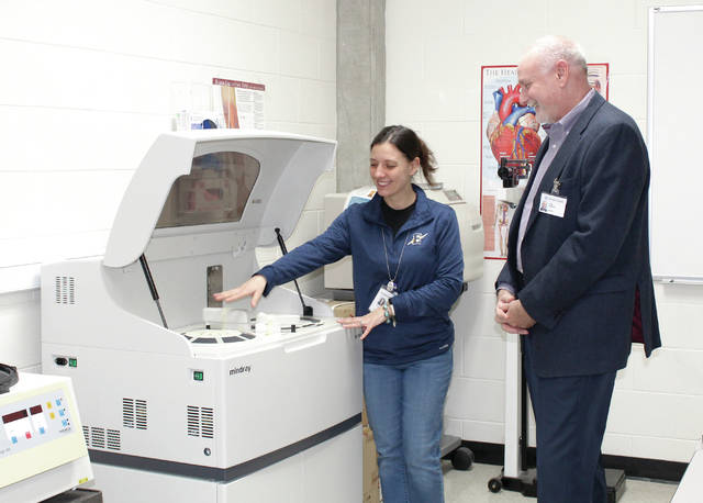 Provided photo Vickie Kirk of Edison State Community College demonstrates for Tom Parker, Upper Valley Medical Center (UVMC) president, new lab equipment purchased by UVMC.