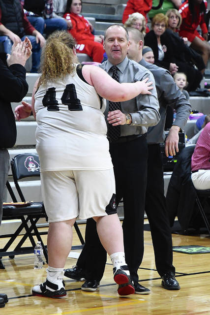 Ben Robinson|GoBuccs.com Covington girls basketball coach Jim Meyer always had a great relationship with his players, like Lauren Christian (44).