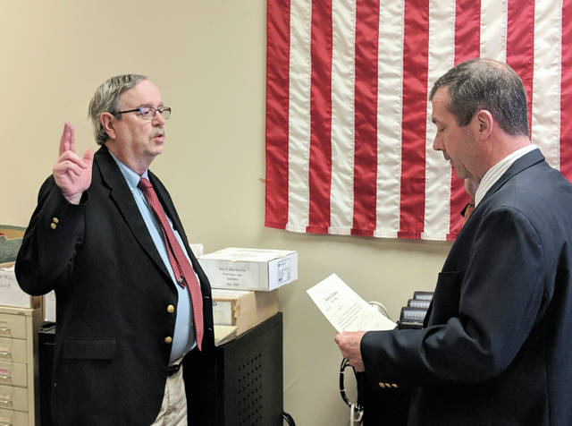 Cecilia Fox | Miami Valley Today The newest member of the Miami County Board of Elections, Jim Oda, was sworn in Wednesday by Judge Samuel Huffman.